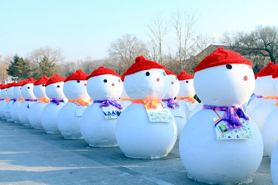 Thousands of snowman arrival in the Harbin Ice Festival